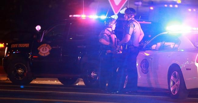 Ferguson officer shot; police say no protest link