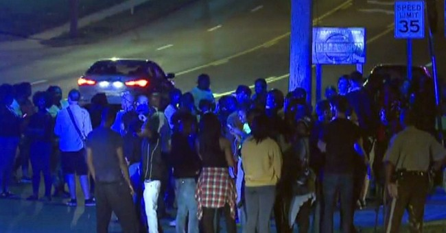 Ferguson officer shot; police say no protest link