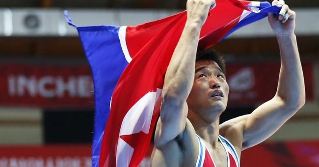 North Koreans at Asian Games 'long for leader'