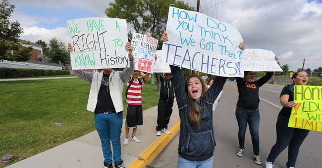 Teachers shut down 2 suburban Denver high schools