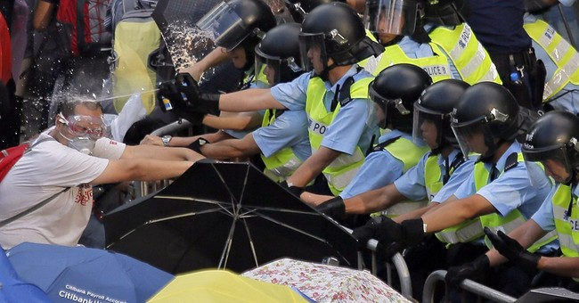China faces tricky balance in Hong Kong's protests