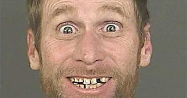 Big smile in Denver bank robbery suspect mug shot