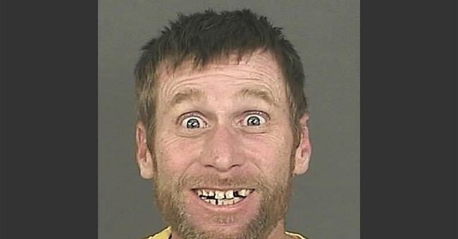 Big smile in Denver bank robbery suspect mug shot