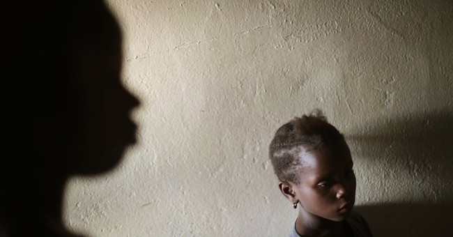 Families wait in agony for word on Ebola patients