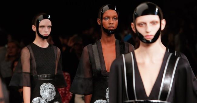 Luhrmann, Gisele hit Chanel's Parisian boulevard