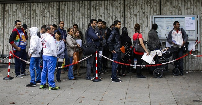 Germany vows better checks on refugee guards