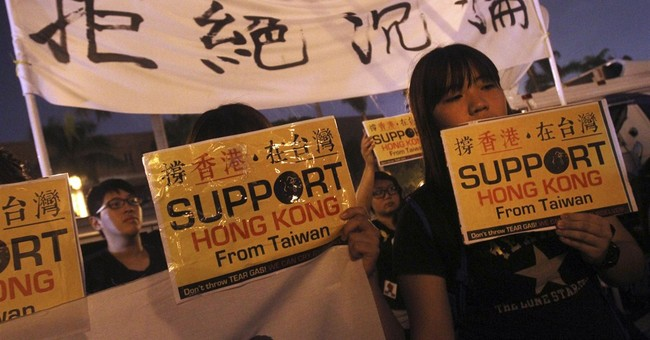 Taiwan throws support behind HK democracy demands