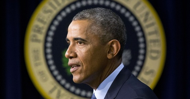 Obama seeks traction on economy amid foreign tests