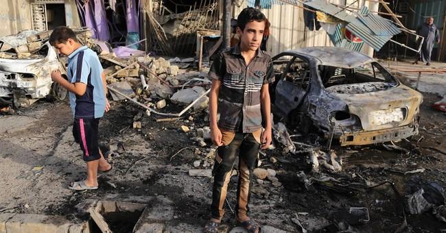 Officials: Baghdad car bomb kills 13