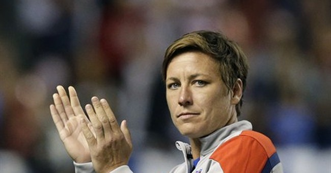 Wambach, players go to court over World Cup turf