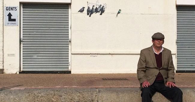 Oops! UK council destroys Banksy immigration mural