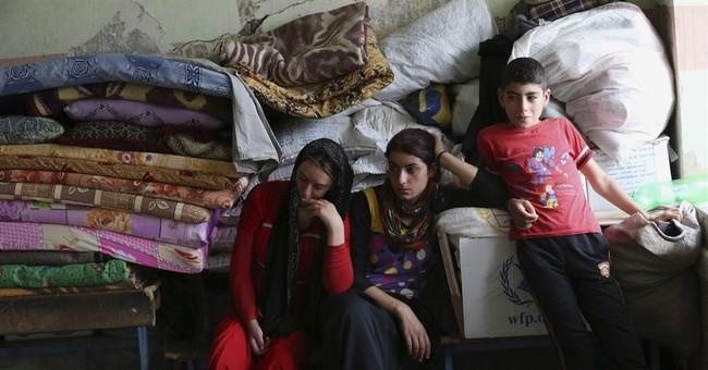 In squalid exile, Iraqi Yazidis hope for return