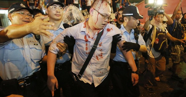 Hong Kong police arrest 19 in protest clash
