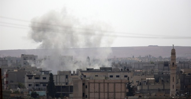 Heavy fighting hits Syrian border town