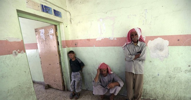 In squalid exile, Iraqi Yazidis hope for return