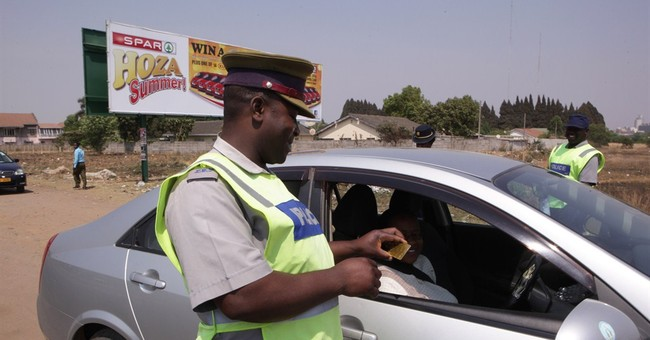 Zimbabwe police are told to smile