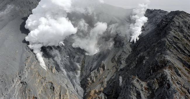 Searchers find 4 more victims on Japanese volcano