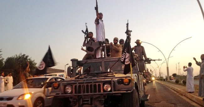 A look at Islamic State beheadings, battle losses