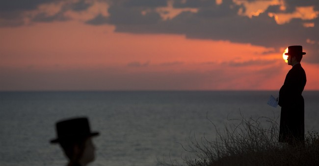 AP PHOTOS: Major Muslim, Jewish holidays coincide