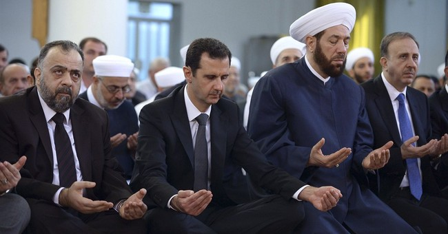 Embattled Syrian president makes rare appearance