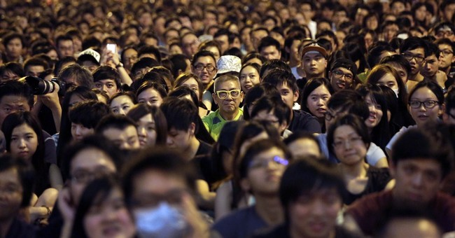 Hong Kong protesters stage massive, defiant rally