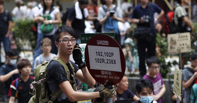 Hong Kong weary, protective, opposed to protesters