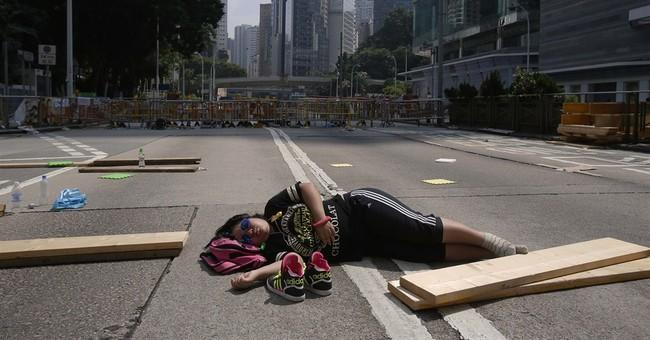 Hong Kong officials resume work as protests thin
