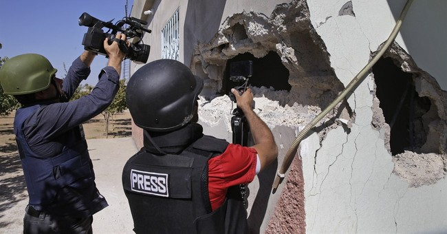 Islamic State fighters shell Syrian Kurdish town