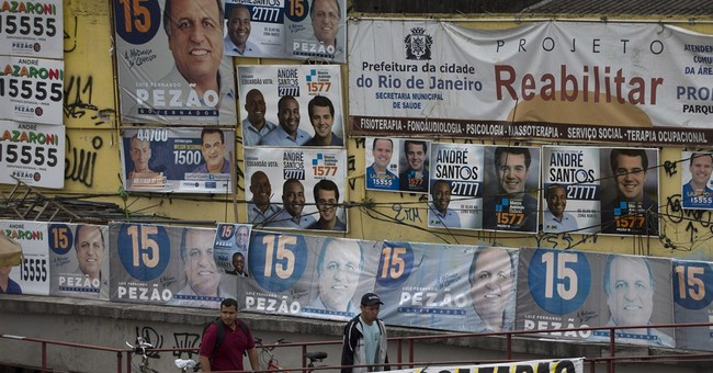 Brazil's Rousseff to face Neves in runoff vote