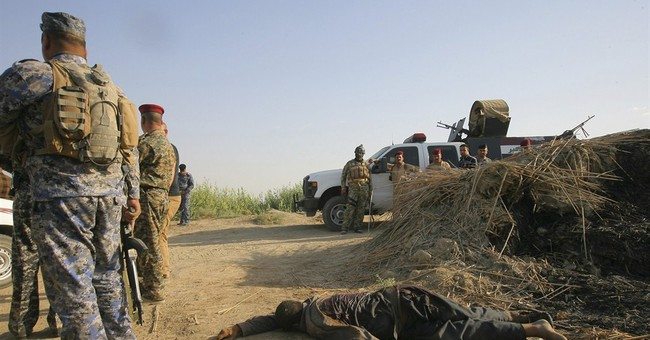 Islamic State group publicly kills 6 Iraqi troops