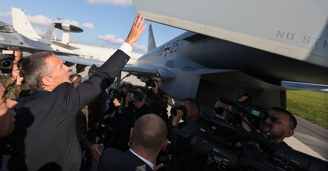 New NATO chief brings Poles message of reassurance