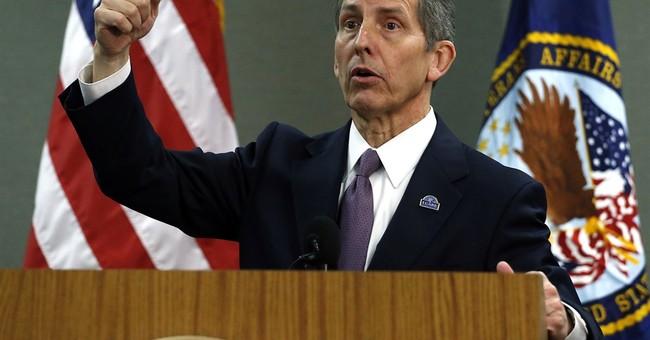 VA moves to ax 4 senior execs in scandal response