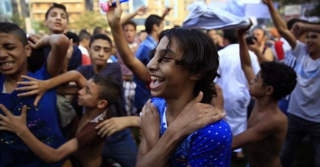 AP PHOTOS: At Eid al-Adha, a weary Egypt rejoices