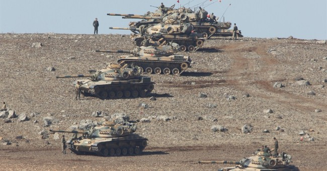 Islamic State wages assault on Syrian border town