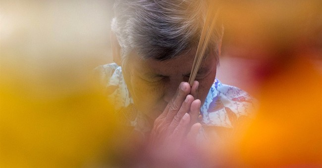 Image of Asia: Praying for Thailand's king