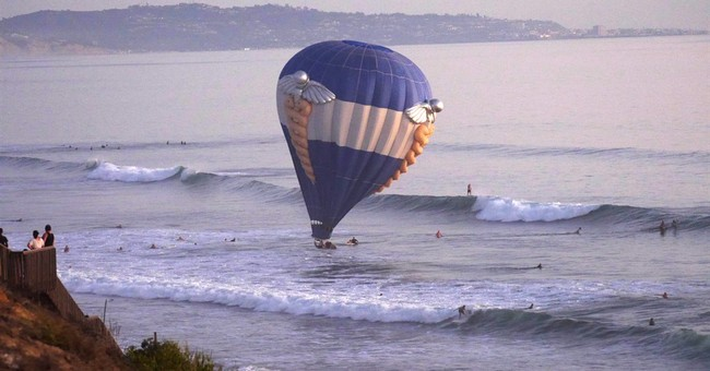 Hot air balloon dips into California sea; 3 saved