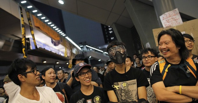 Hong Kong protests thin as two sides agree to talk