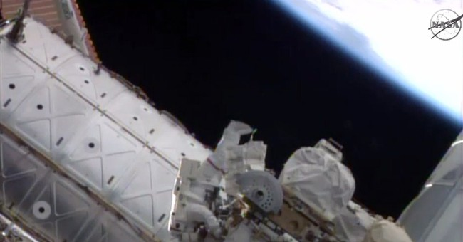 Astronauts resume routine spacewalks for NASA