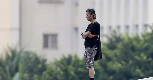Murky players emerge from within Hong Kong protest