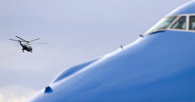 Obama keeps his distance from the campaign trail