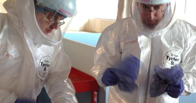 Ebola training focuses on astronaut-like gear