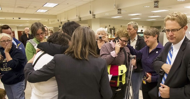 Tears, cheers as gay couples get married in Vegas