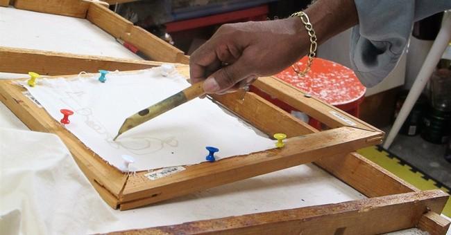 Black artist uses Confederate flag to create art