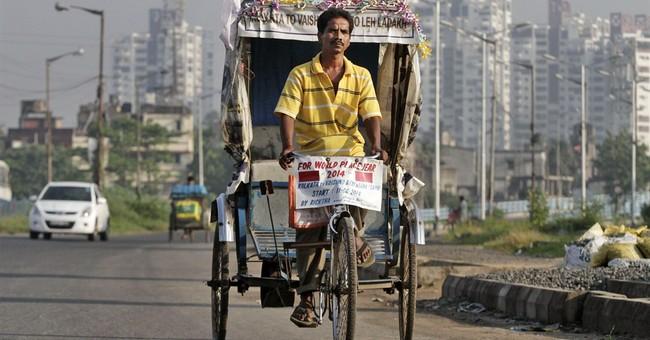 Indian man pedals cycle rickshaw to Himalayan pass