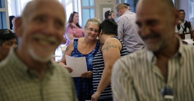Tears, cheers as gay couples get married in Vegas