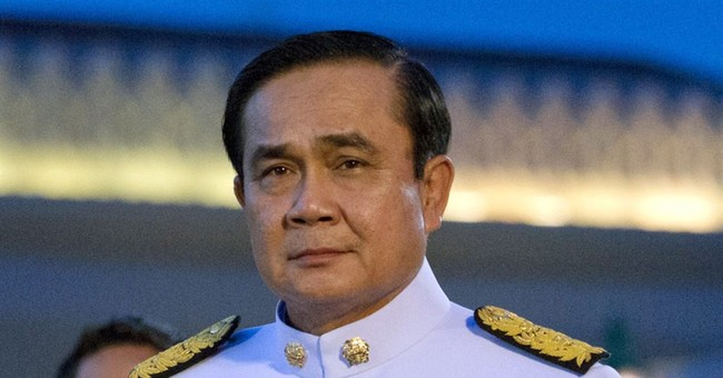 Thai coup leader visits Myanmar on 1st trip abroad