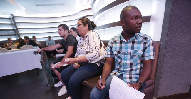 Applications for US unemployment aid fall to 287K