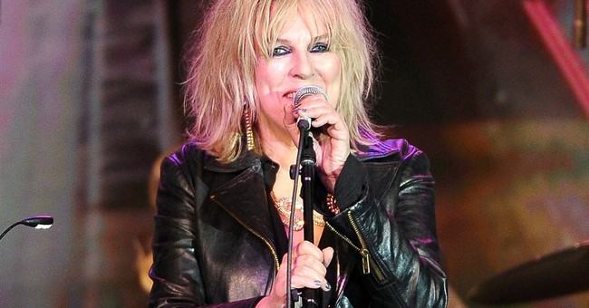 Lucinda Williams puts her father's poem to music