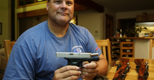 Rival gun measures on ballot in Washington state