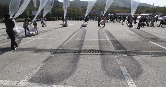 Rival Koreas trade fire over propaganda balloons
